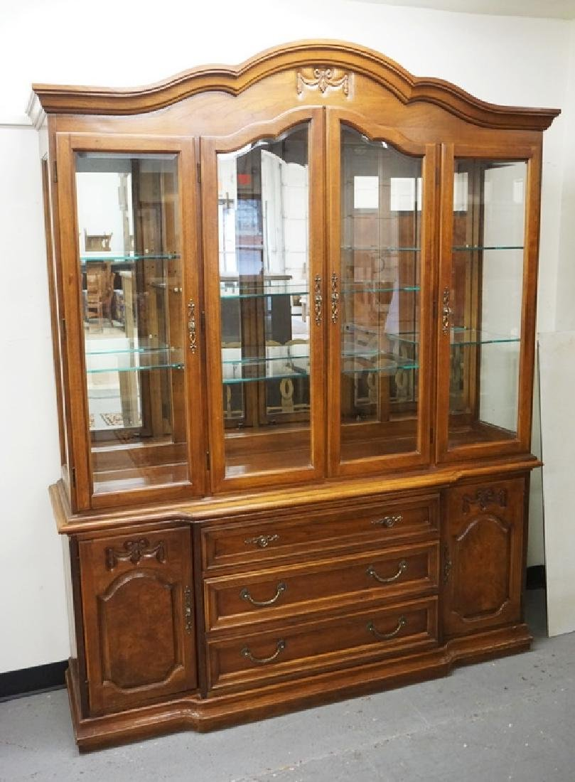 THOMASVILLE WALNUT BREAKFRONT WITH GLASS SHELVES, A