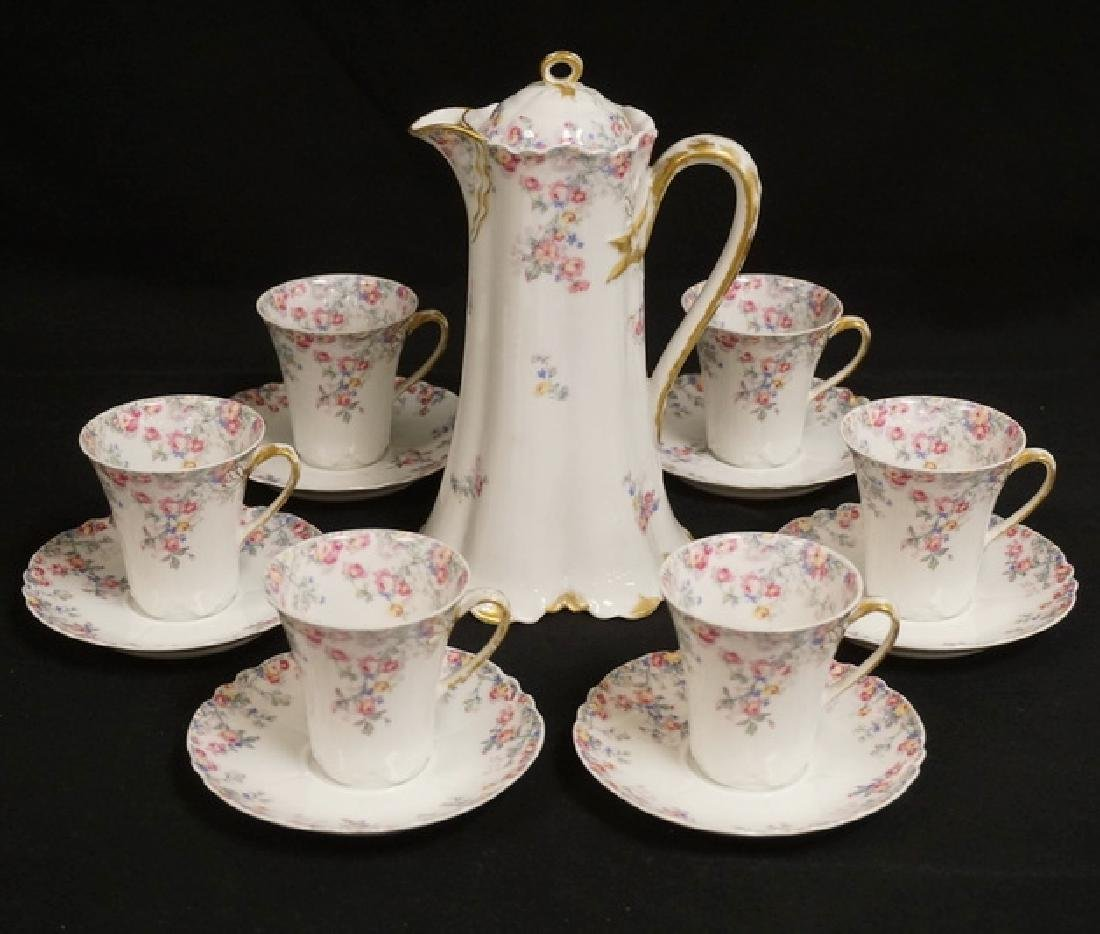 HAVILAND LIMOGES CHOCOLATE POT WITH 6 CUPS AND SAUCERS.
