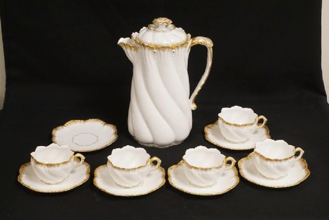 LIMOGES FRANCE COFFEE POT WITH 5 CUPS AND 5 SAUCERS.