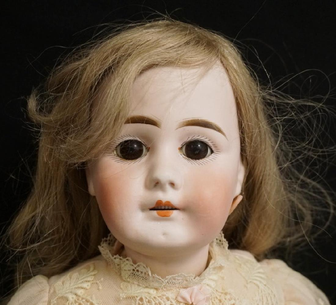 GERMAN BISQUE HEAD DOLL MEASURING 22 INCHES LONG. - 2