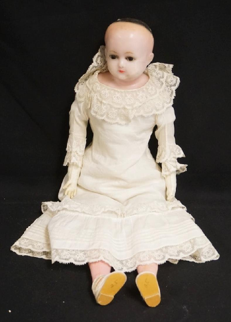 ANTIQUE WAX DOLL. 21 INCHES LONG.