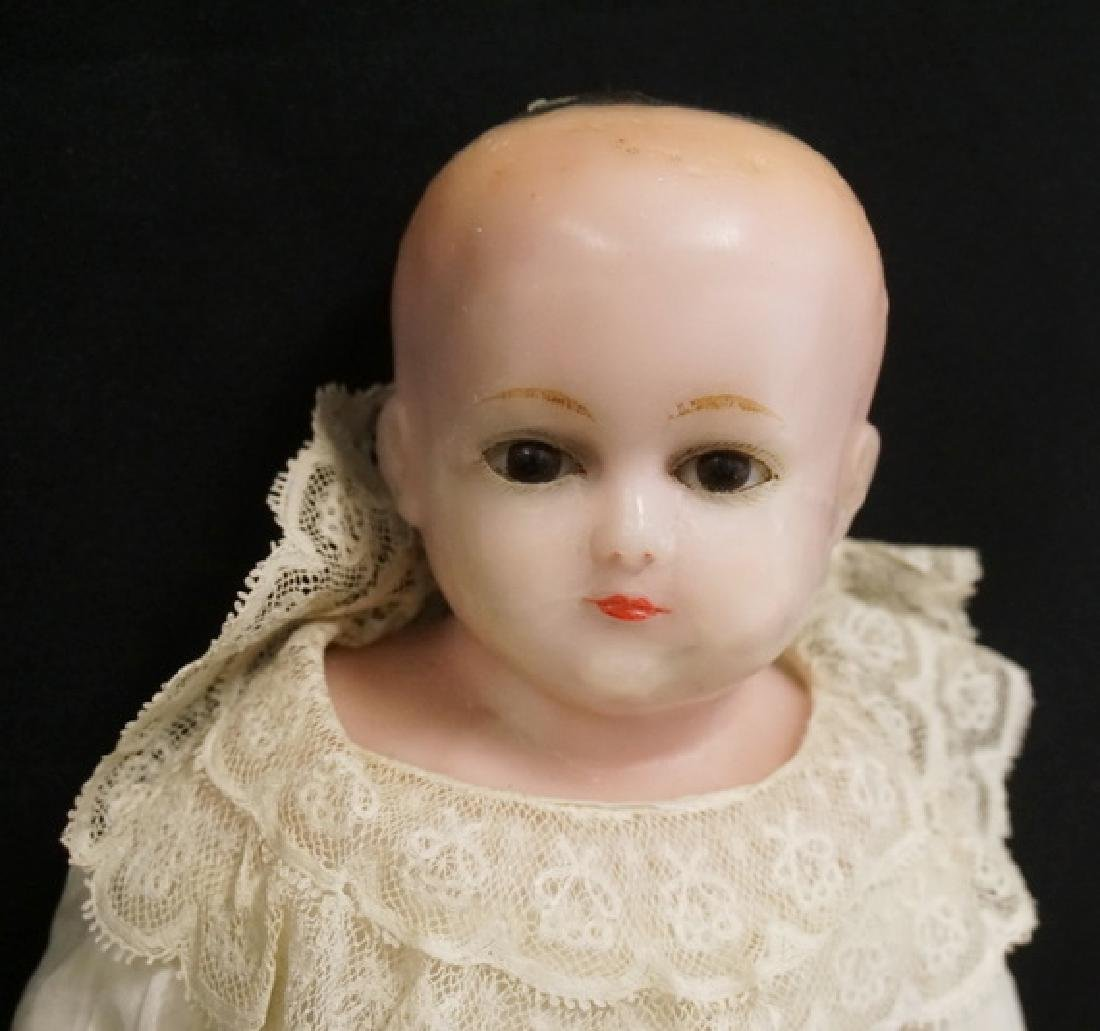 ANTIQUE WAX DOLL. 21 INCHES LONG. - 2