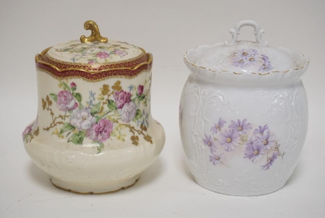 LOT OF 2 HAND PAINTED PORCELAIN BISCUIT JARS. ONE IS