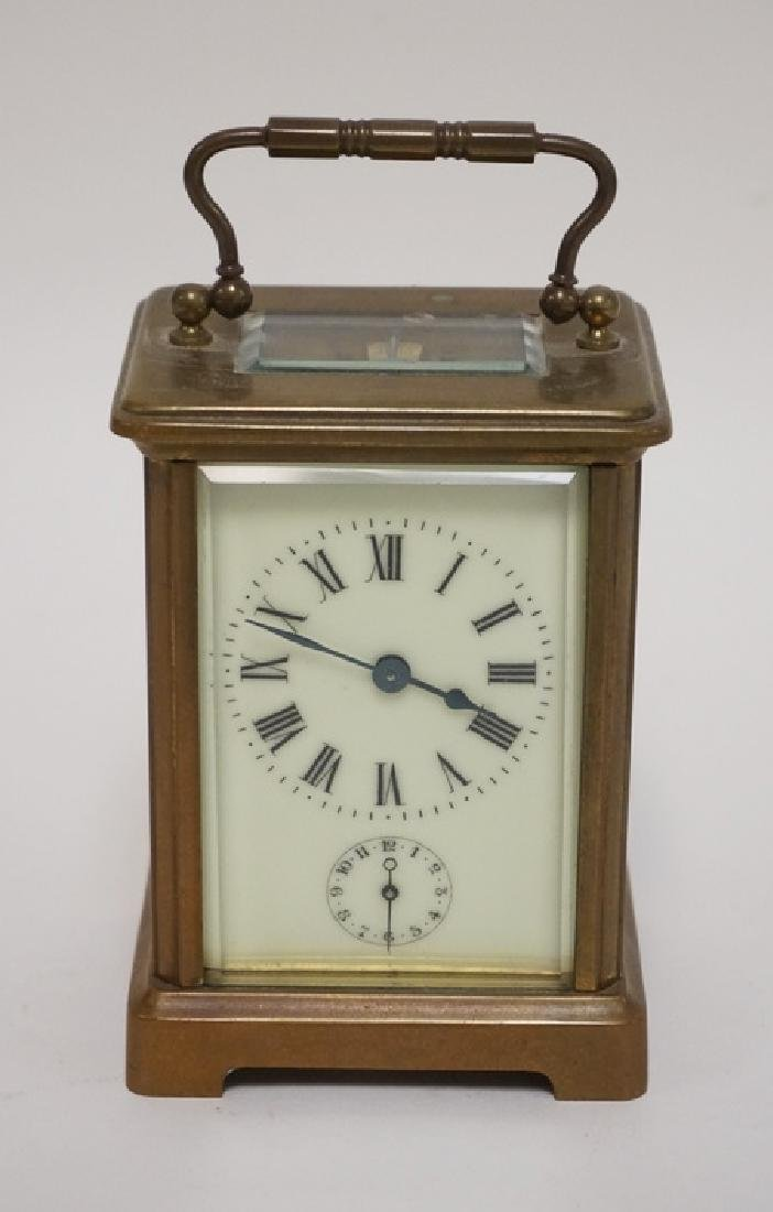 BRASS CARRIAGE CLOCK WITH BEVELED GLASS SIDES.