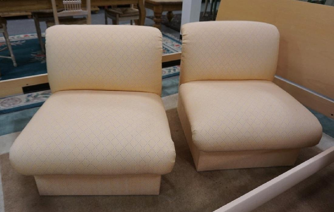 PAIR OF PEACH COLORED UPHOLSTERED BOUDOIR CHAIRS.
