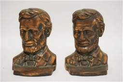 PAIR OF CAST IRON ABRAHAM LINCOLN BOOKENDS WITH A