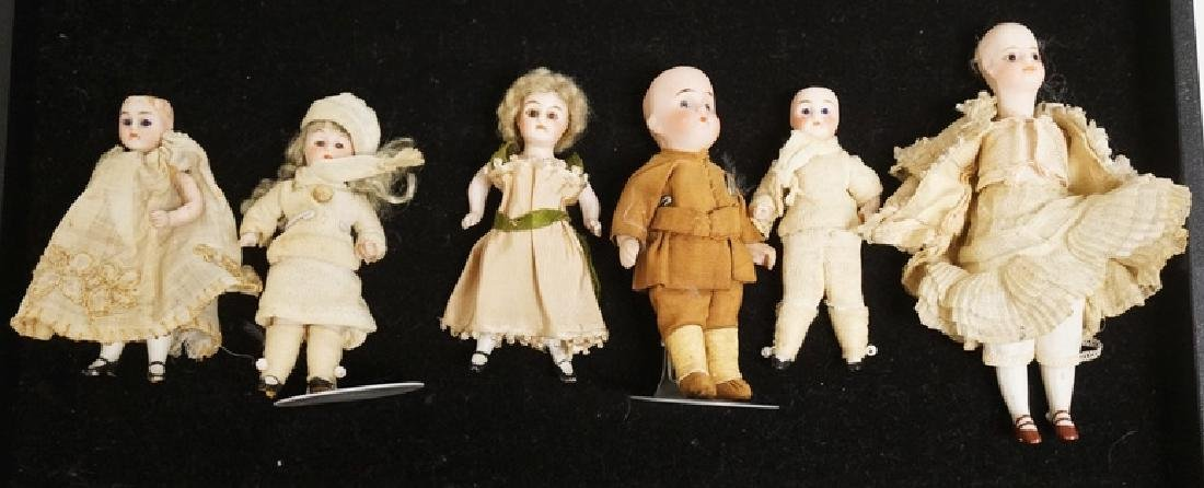 GROUP OF 6 MINIATURE BISQUE HEAD DOLLS. TALLEST IS 5