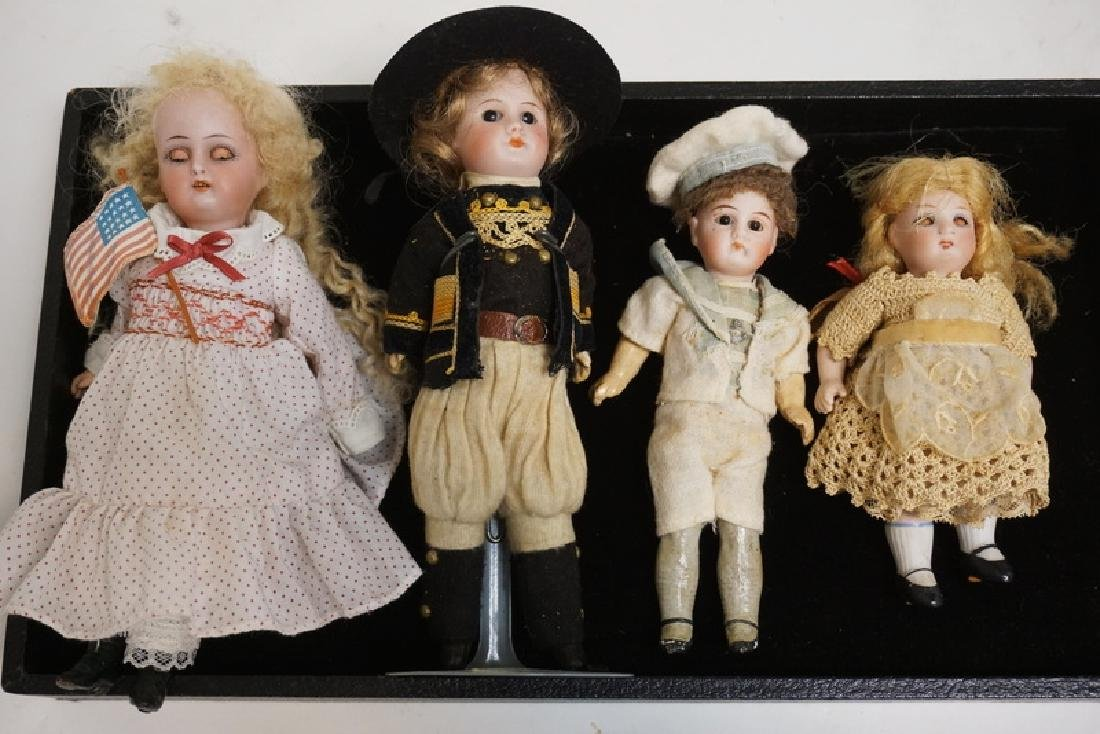LOT OF 4 MINATURE BISQUE HEAD DOLLS. TALLEST IS 7 1/2