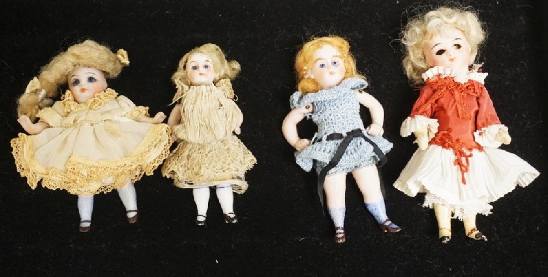 LOT OF 4 MINATURE BISQUE HEAD DOLLS. TALLEST IS 4 1/2