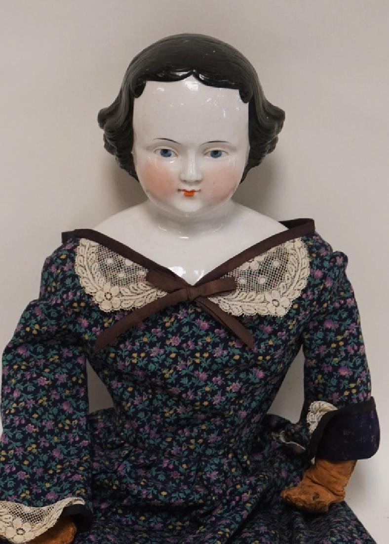 CHINA HEAD DOLL WITH LEATHER ARMS. 25 INCHES TALL. - 2