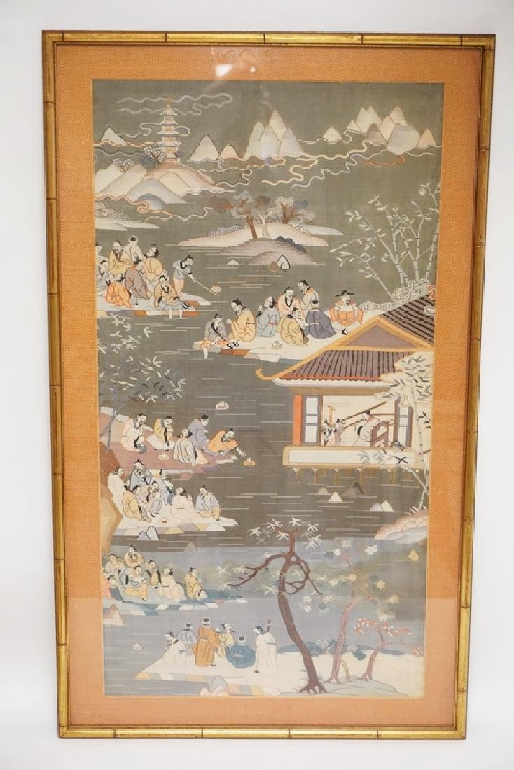 FRAMED ASIAN FABRIC PANEL DEPICTING FIGURES AMONGST A