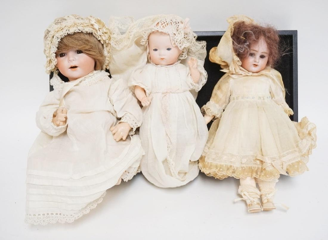 GROUP OF 3 GERMAN BISQUE HEAD DOLLS. TALLEST IS 10 1/2