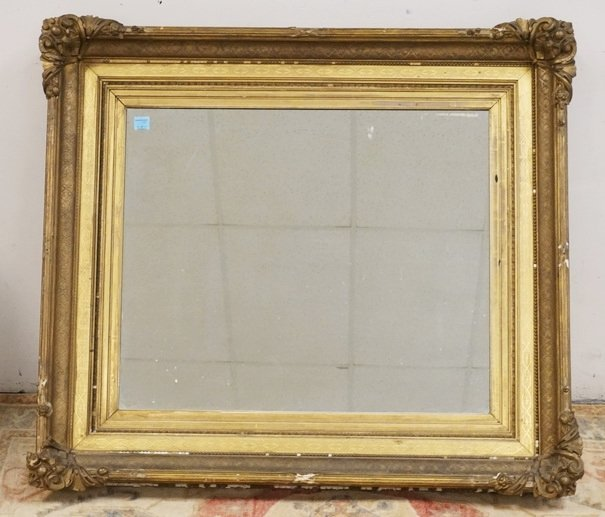 LARGE MIRROR WITH A THICK GOLD GILT FRAME. HAS LOSSES.