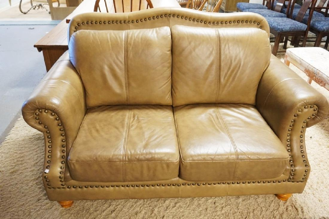 LIGHT BROWN LEATHER LOVESEAT MEASURING 62 INCHES WIDE.