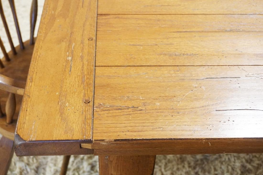 OAK DINING TABLE WITH 4 CHAIRS. HAS 2 ADD ON LEAVES FOR - 2