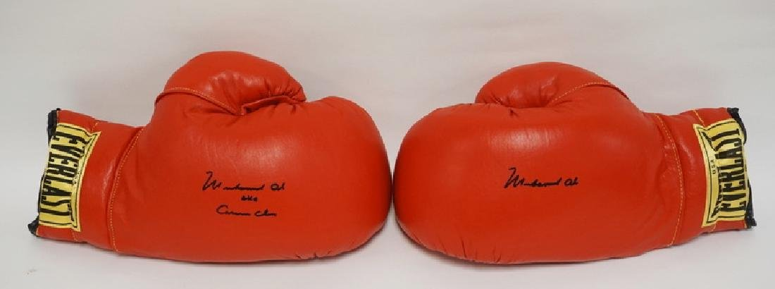 PAIR OF MUHAMMAD ALI SIGNED BOXING GLOVES. ONE SIGNED