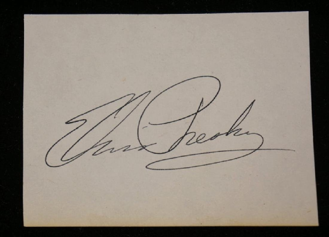 ELVIS PRESLEY CUT SIGNATURE ON PAPER.