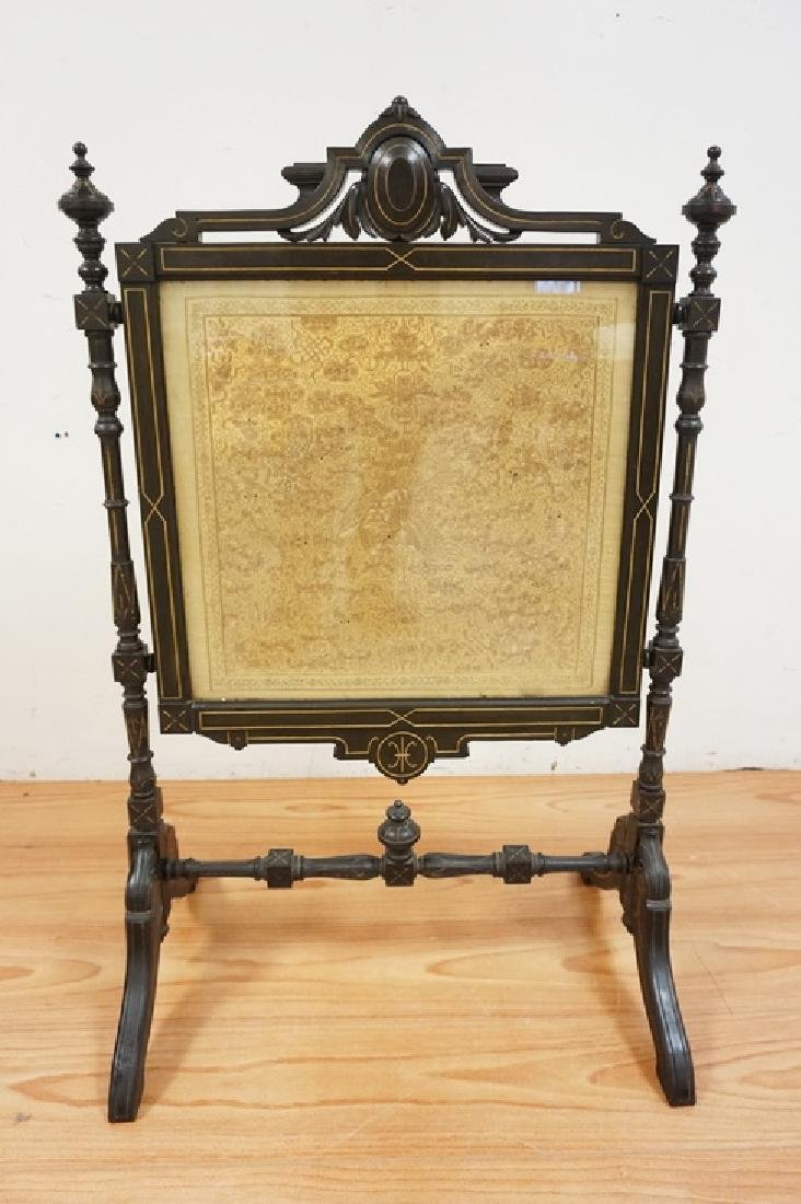 CARVED VICTORIAN FIRE SCREEN WITH A DECORATIVE PANEL