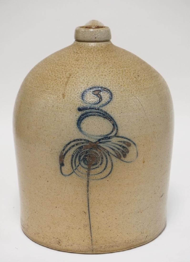 3 GALLON STONEWARE JUG DECORATED WITH A BLUE STYLIZED