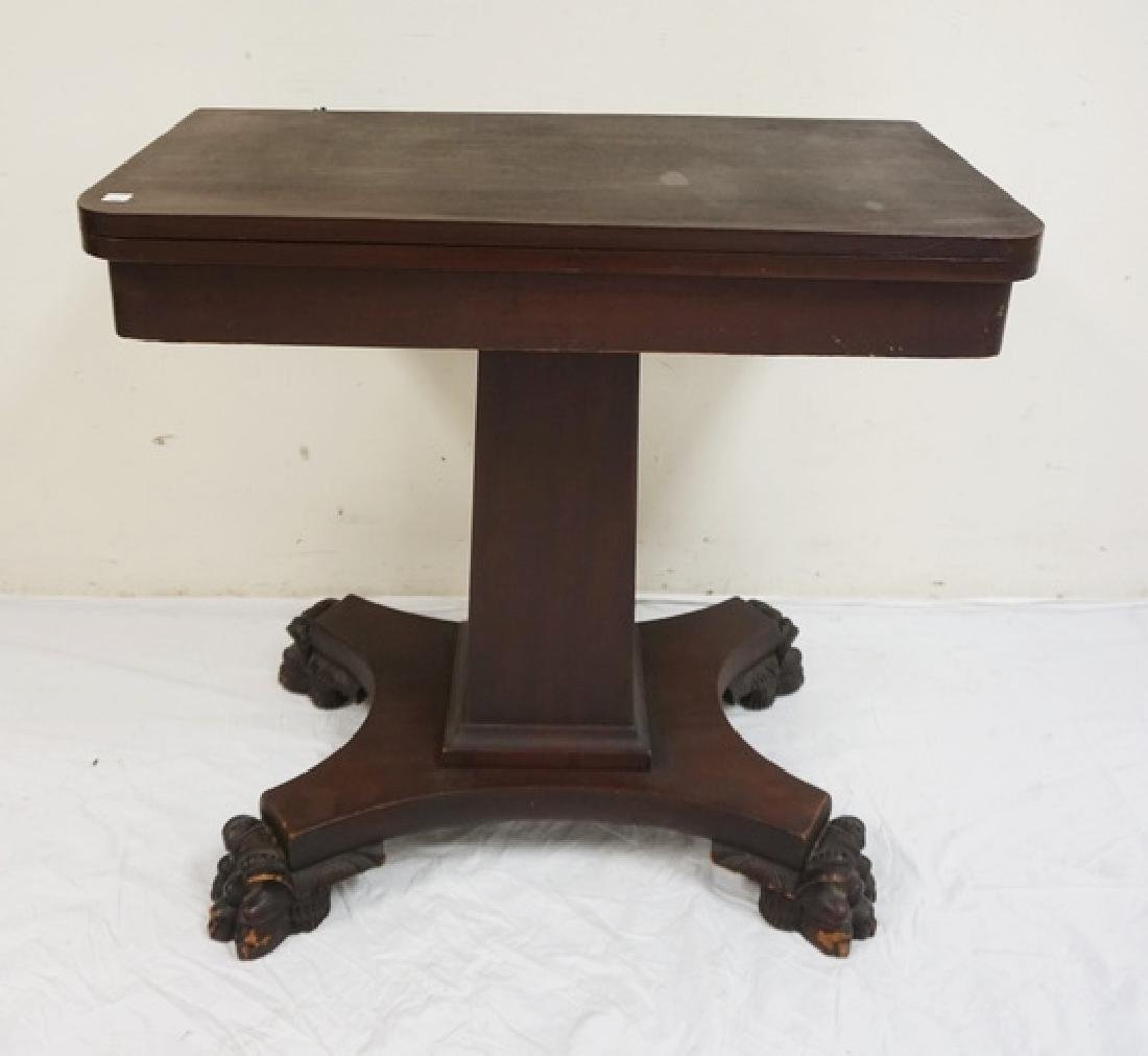 EMPIRE MAHOGANY GAME TABLE WITH LARGE PAW FEET. 29