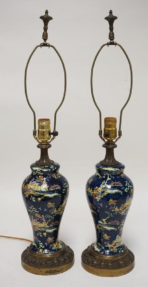 PAIR OF J.W. & CO STAFFORDSHIRE TABLE LAMPS IN AN ASIAN