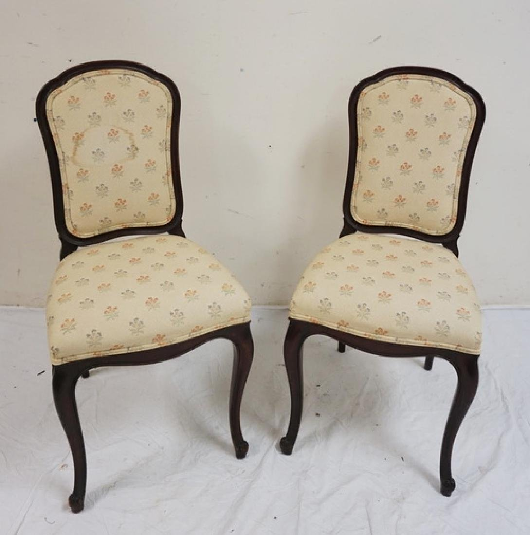 PAIR OF CARVED MAHOGANY SIDE CHAIRS. UPHOLSTERY ON ONE