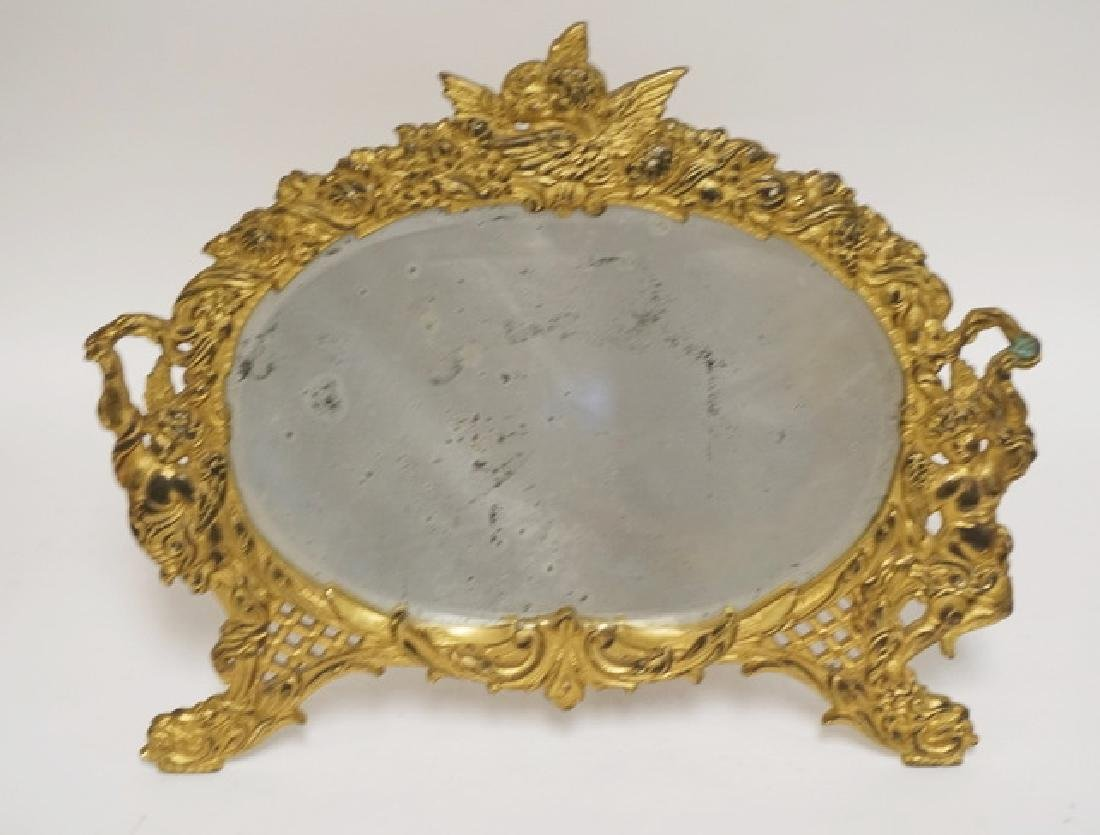 GOLD GILT CAST IRON MIRROR WITH CHERUB FIGURES. 16 X 13