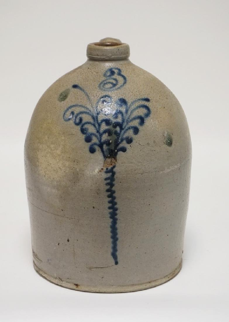 STONEWARE JUG. BLUE DECORATED WITH A STYLIZED FLOWER. 3