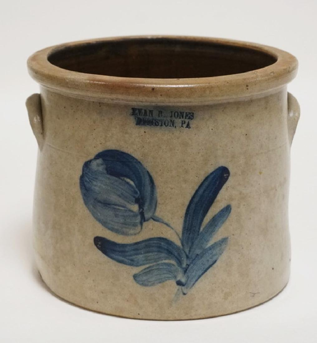 STONEWARE CROCK. BLUE DECORATED WITH A FLOWER. *EVAN R.