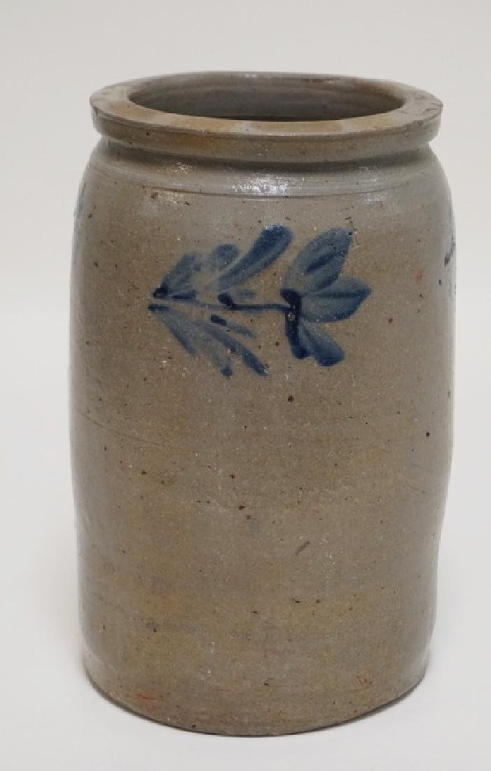 STONEWARE CROCK. BLUE CECORATED WITH 3 FLOWERS. 10 1/2