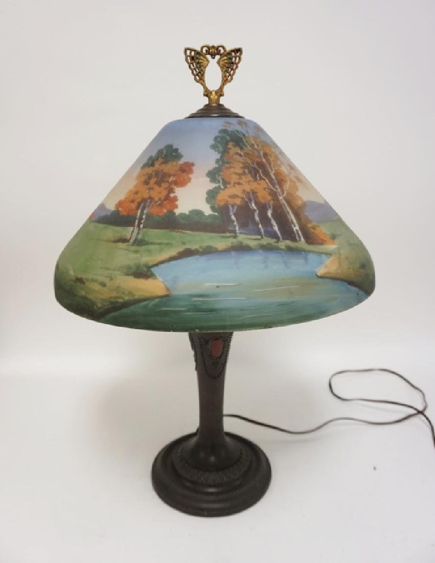 REVERSE PAINTED TABLE LAMP WITH AN ORNATE WHITE METAL