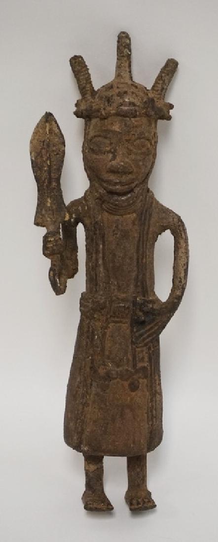 ASIAN BRONZE SCULPTURE OF A STANDING FIGURE HOLDING AN