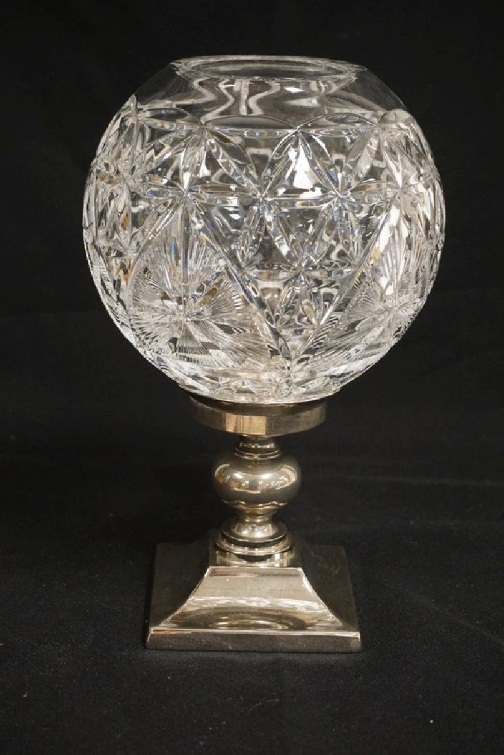 WATERFORD CANDLE STICK HAVING A SILVER PLATED BASE AND