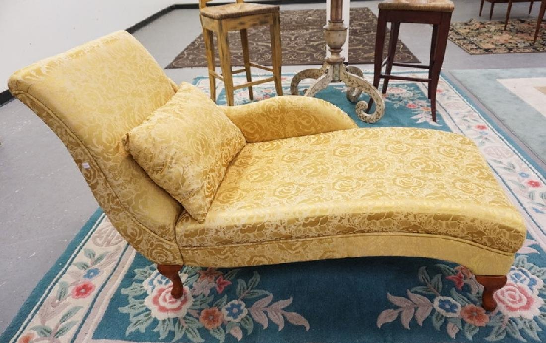 CHAISE LOUNGE IN GOLD ROSE PATTERNED UPHOLSTERY.