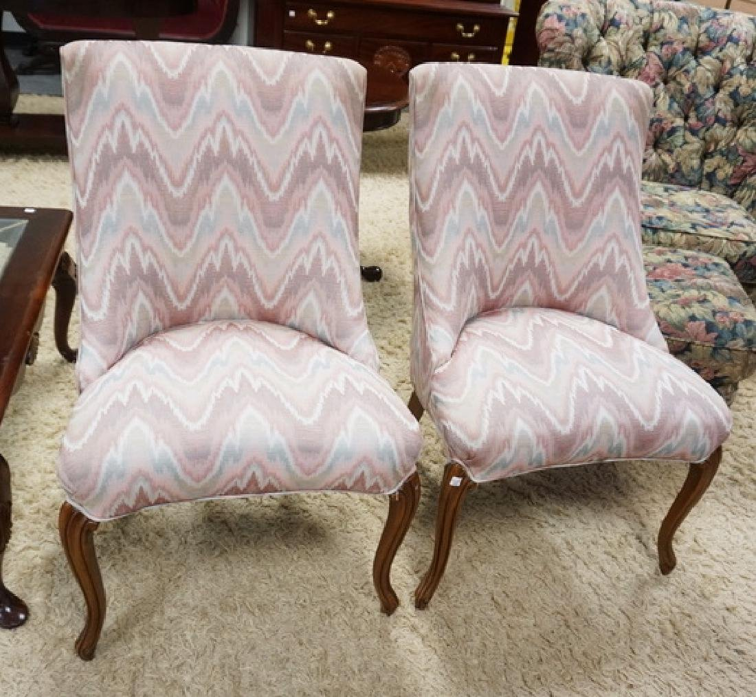 PAIR OF UPHOLSTERED CHAIRS.