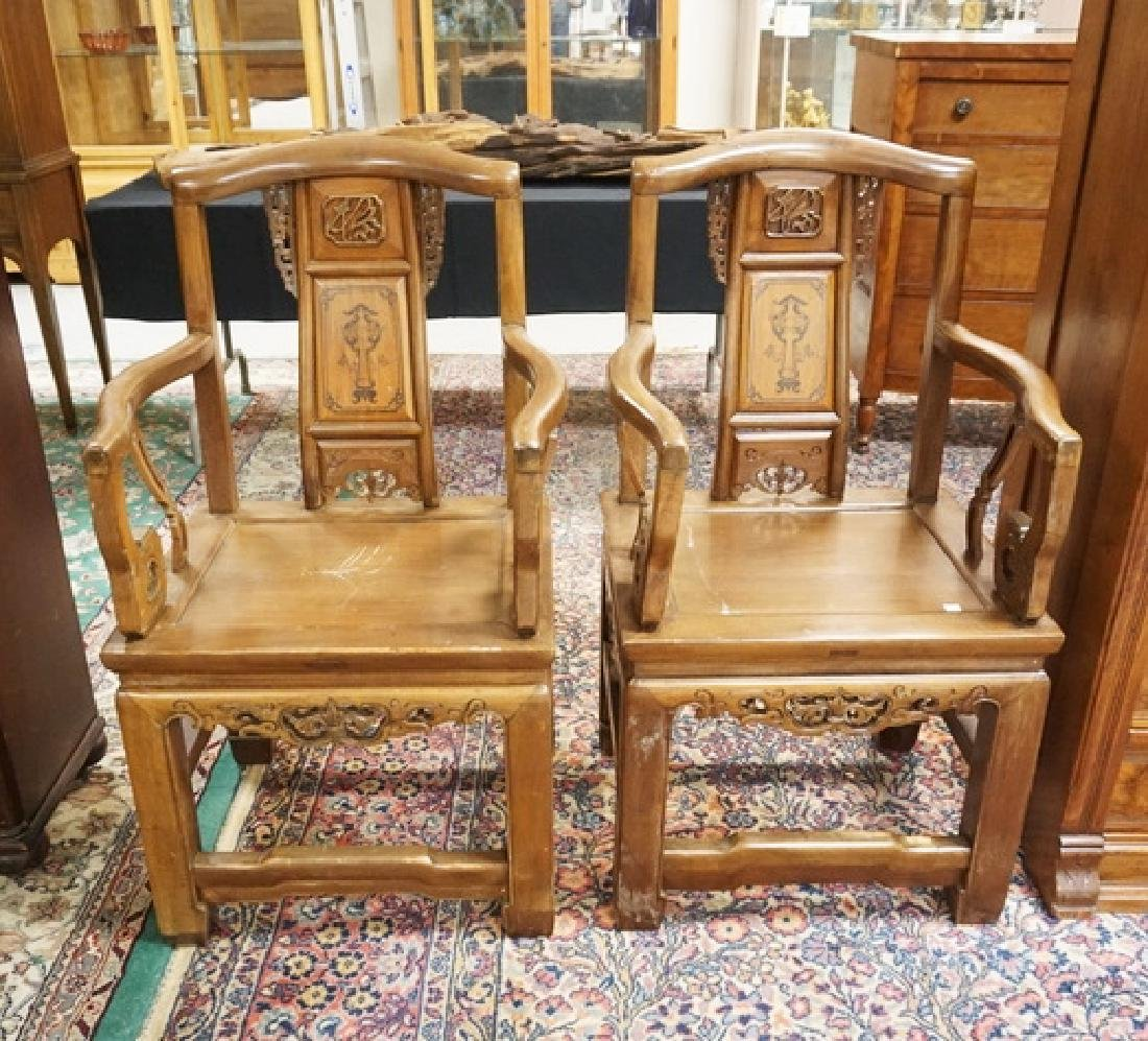 PAIR OF ASIAN CARVED HARDWOOD CHAIRS.