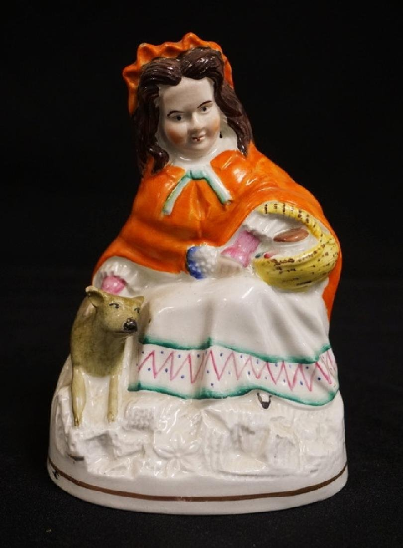 STAFFORSHIRE PORCELAIN FIGURE OF A WOMAN WITH A DOG. 6