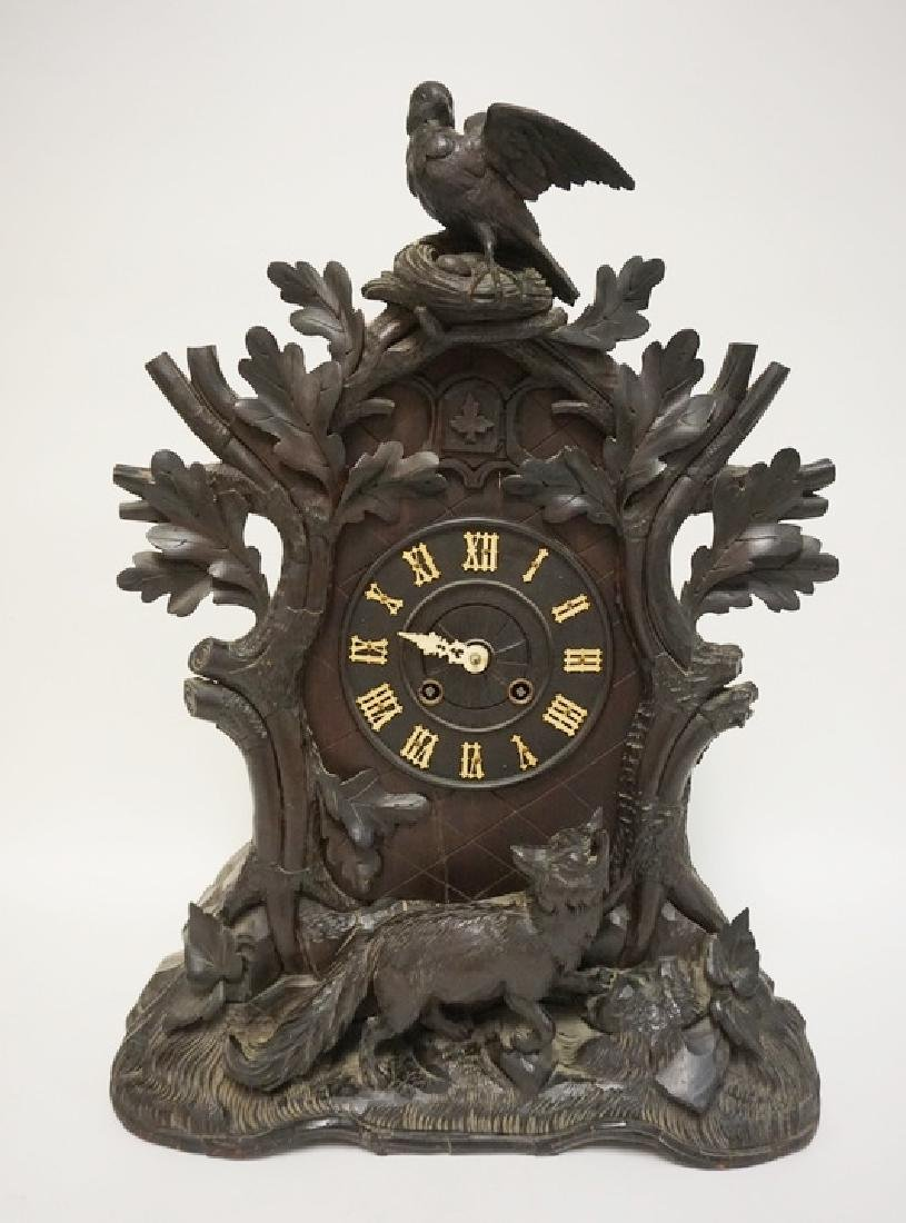 HEAVILY CARVED BLACK FOREST WALNUT CLOCK WITH BIRD,