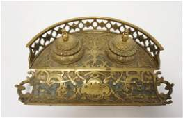 ORNATE VICTORIAN BRASS DOUBLE INKWELL. ONE GLASS INSERT