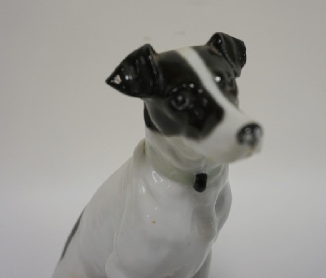 PORCELAIN SITTING DOG. HAS MAKERS MARK UNDER FRONT - 2