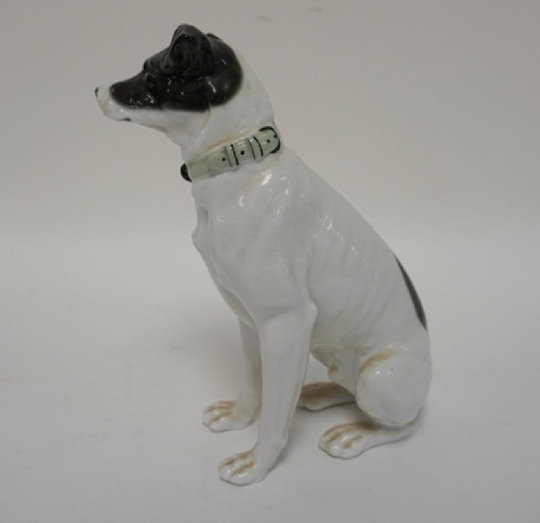 PORCELAIN SITTING DOG. HAS MAKERS MARK UNDER FRONT - 3