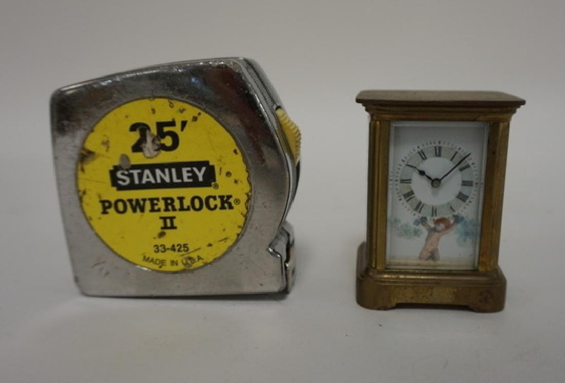 MINIATURE BRASS CARRIAGE CLOCK WITH HAND PAINTED CHERUB