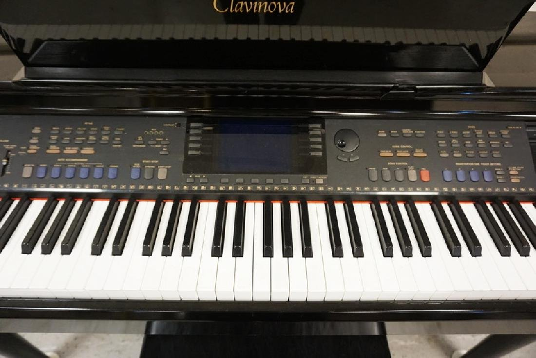 YAMAHA CLAVINOVA. BLACK LACQUER FINISH. COMES WITH - 2