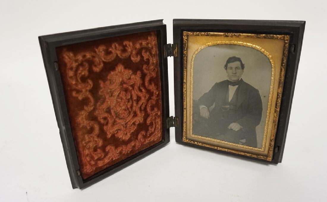 LARGE HARD CASED IMAGE OF A GENTLEMAN. 2 SMALL CHIPS ON