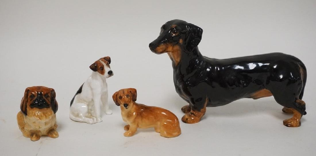 GROUP OF 4 ROYAL DOULTON PORCELAIN DOGS. TALLEST 4 IN