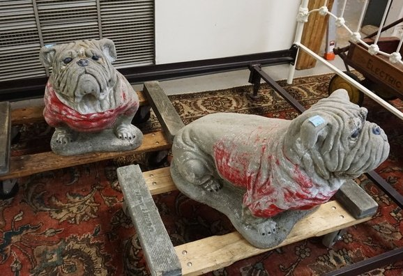 PAIR OF CONCRETE BULLDOGS. 18 IN H, 24 IN LONG