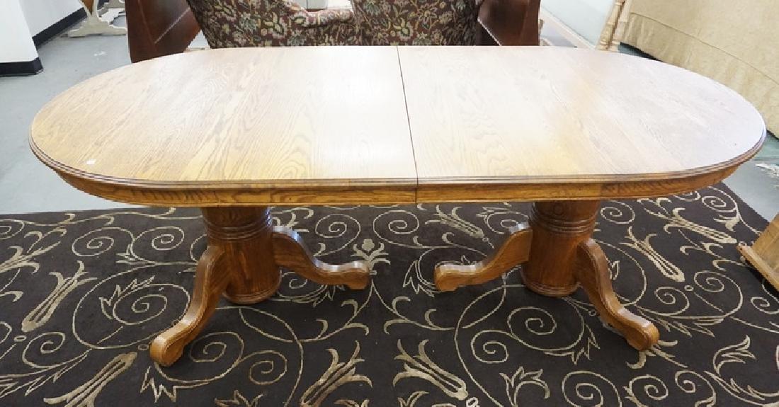 OVAL OAK DINING TABLE W/TWO 16 1/.2 IN LEAVES. 83 IN X
