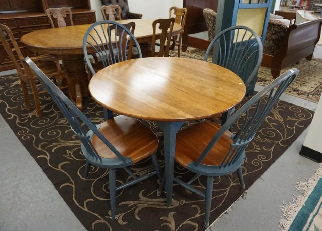DINETTE TABLE AND 4 CHAIRS. ONE 18 IN LEAF. 42 IN DIA