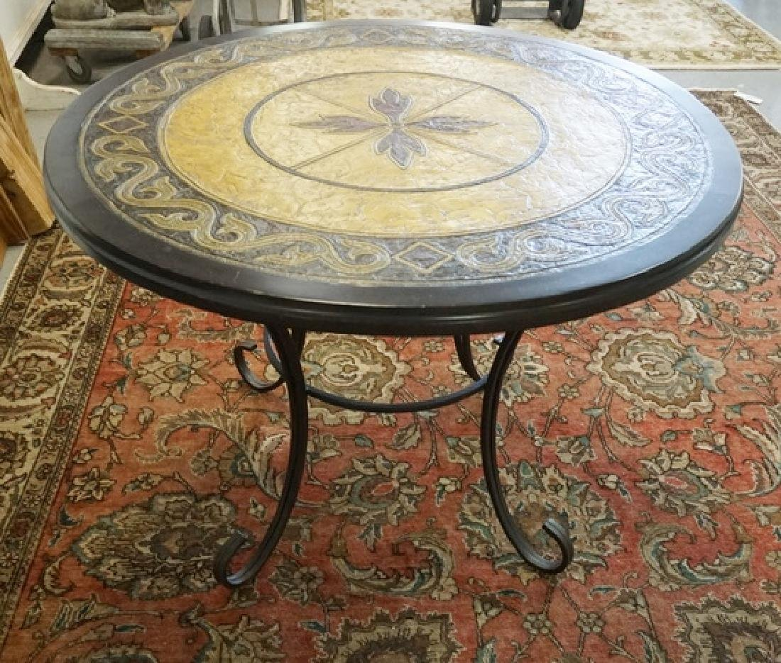 ROUND TABLE HAVING A TOOLED AND COLORED LEATHER TOP AND
