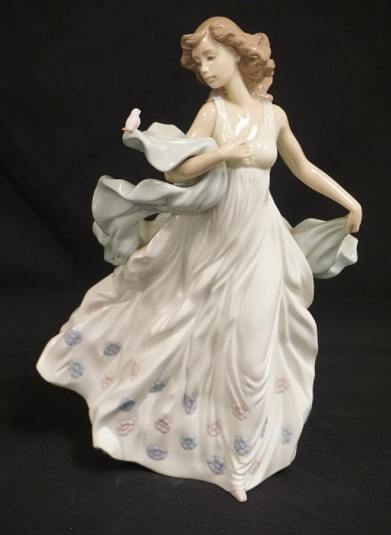LLADRO PORCELAIN FIGURE OF A WOMAN IN A LONG FLOWING